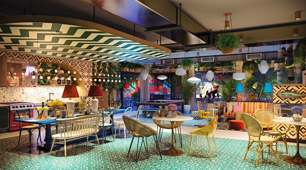 A flashy lounge area with multi-colored tables and flooring, and a chevron pattern on the ceilings. There's many hanging planters and light fixtures.