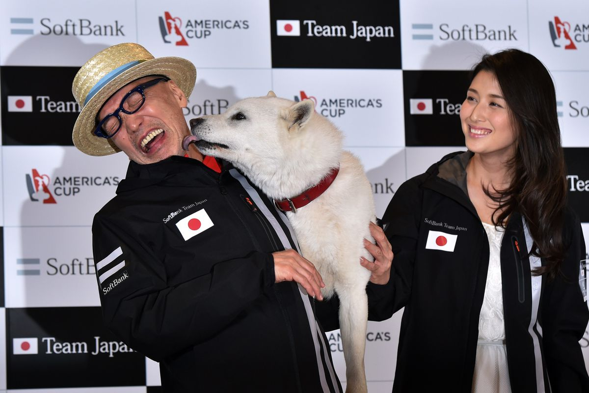 Tv Commentator Terry Ito Left Is Licked By The Softbank Mascot Dog As Japanese Actress Manami Hashimoto Right Smiles Yoshikazu Tsunoafpgetty Images