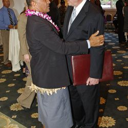 """Former BYU and NFL star Vai Sikahema (left) and Mark Willes, President and CEO of Deseret Management Corporation greet each other at the Pacific Islander conference """"Navigating the Future"""" sponsored by the Deseret News as a forum for different issues for Polynesians at the Joseph Smith Building Wednesday, Sept. 21, 2011, Salt Lake City, Utah."""