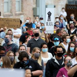 People take part in a vigil organized by Unified Allies 4 Change at the Provo Police Department on Friday, June 5, 2020, for all those who have lost their lives to police brutality.