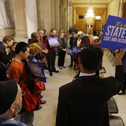 """Freedom Indiana faith leaders hold a prayer walk through the halls of the Statehouse before a hearing on bills concerning LGBT civil rights and religious freedom in front of the Senate Committee on Rules and Legislative Procedure at the Statehouse in Indianapolis on Jan. 27, 2016. Half of U.S. adults believe religious responses to LGBT issues alienate young people, who may be turned off by a """"judgmental"""" stance toward gays and lesbians."""
