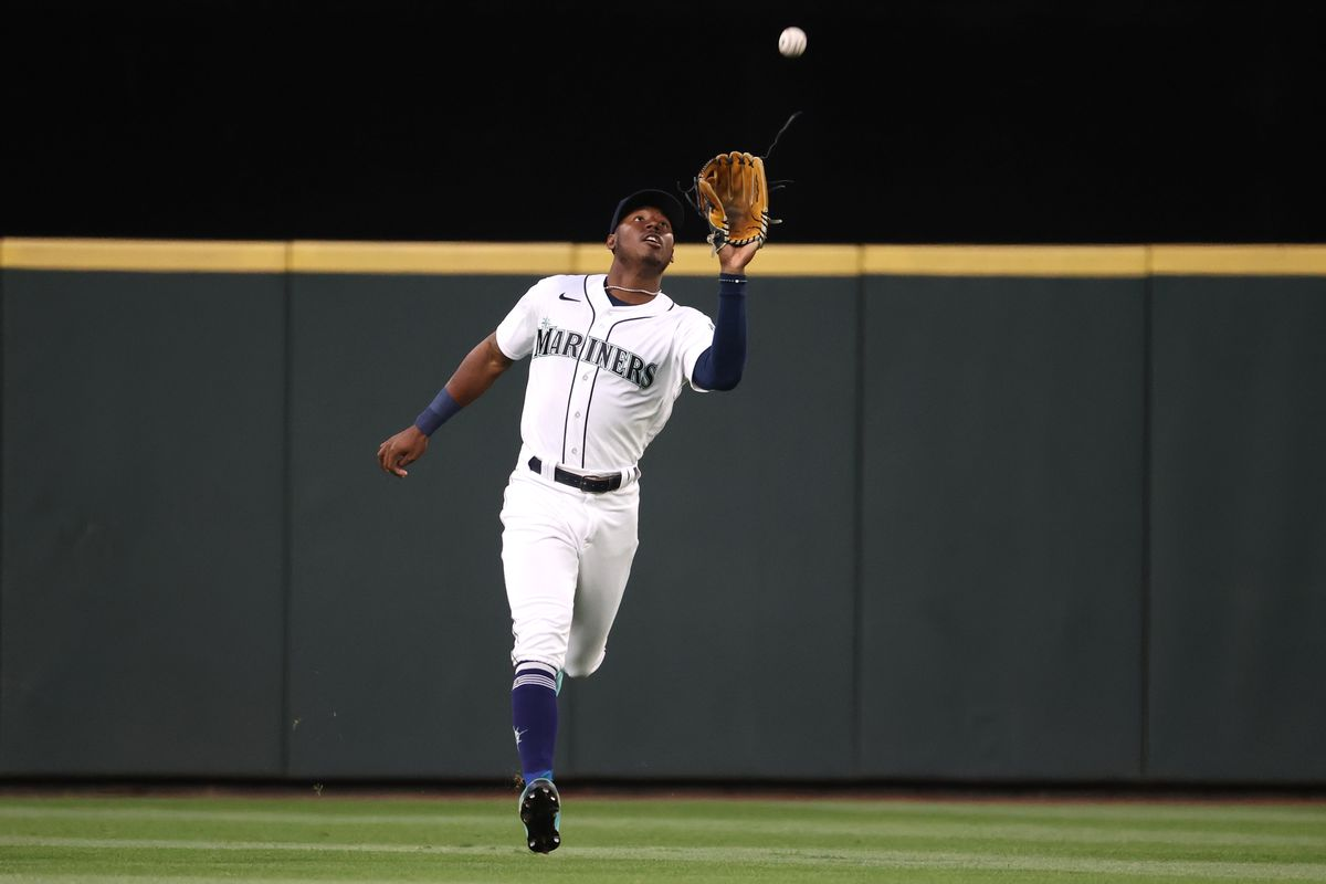 Kyle Lewis #1 of the Seattle Mariners catches a fly out by Isiah Kiner-Falefa #9 of the Texas Rangers during the sixth inning at T-Mobile Park on May 29, 2021 in Seattle, Washington.