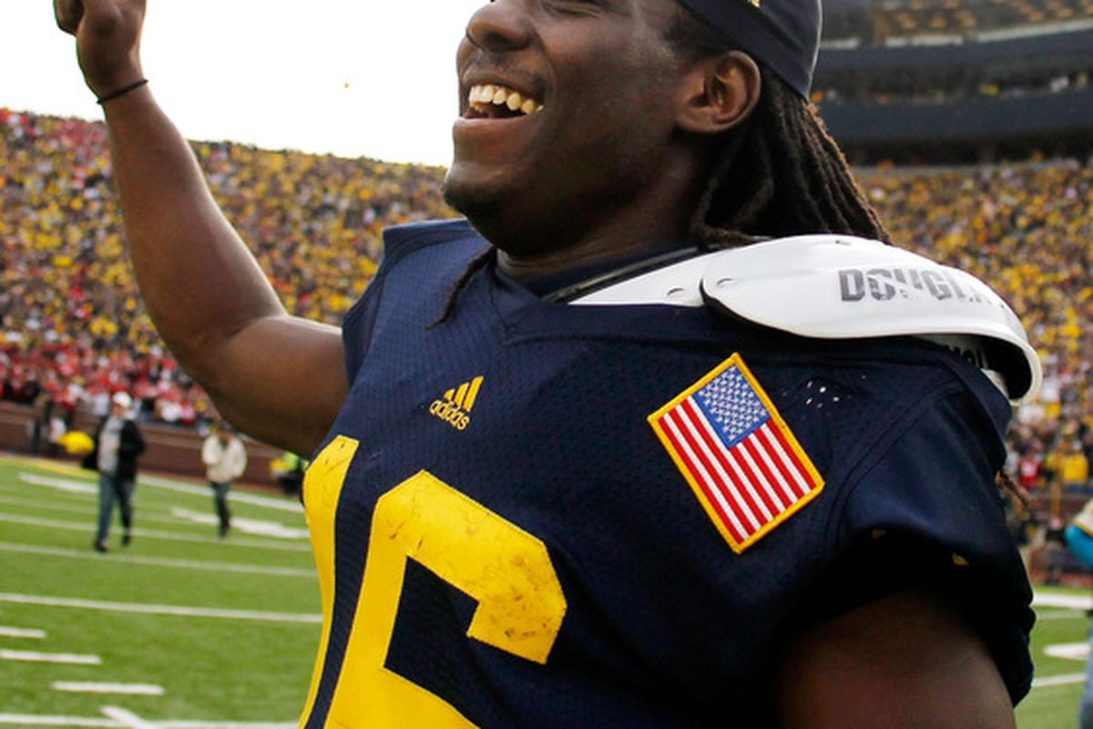 ANN ARBOR, MI - NOVEMBER 26:  Denard Robinson #16 of the Michigan Wolverines celebrates after beating Ohio State 40-34 at Michigan Stadium on November 26, 2011 in Ann Arbor, Michigan. (Photo by Gregory Shamus/Getty Images)