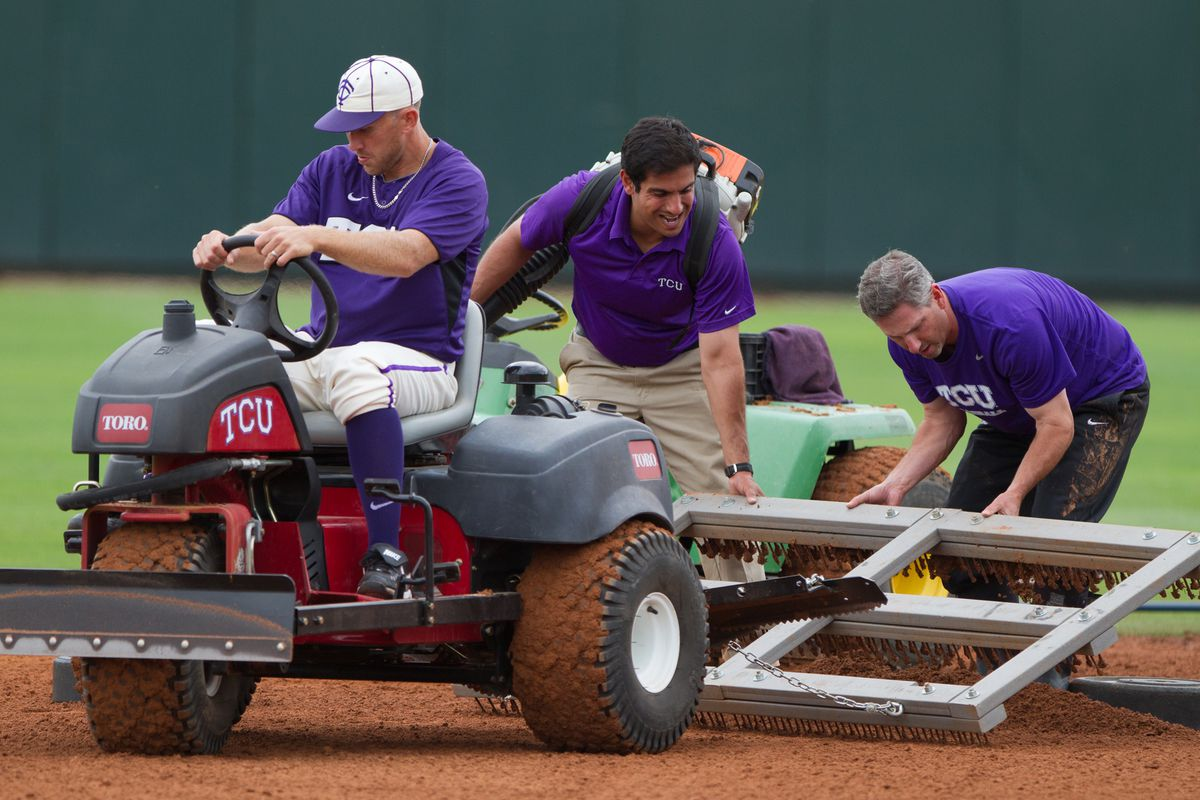 Grounds crew works on the field at Lupton Stadium