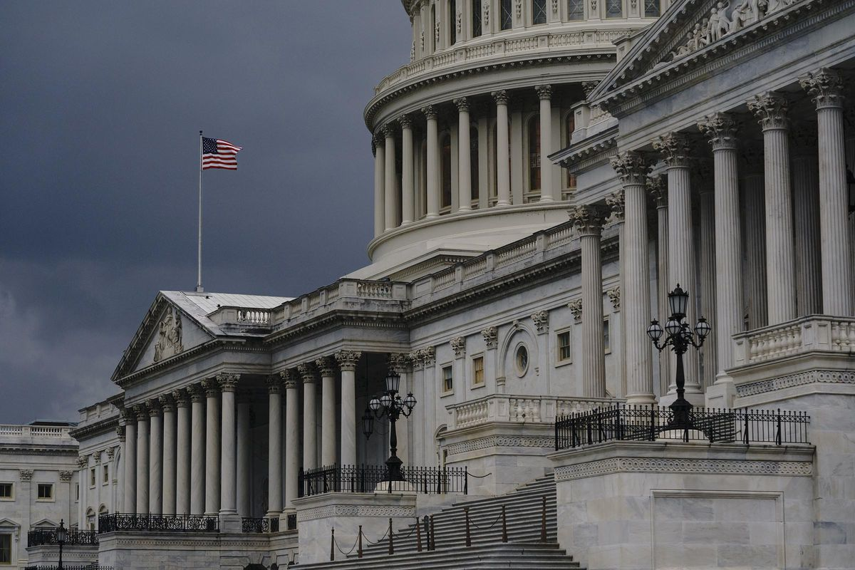 Dark clouds and heavy rain sweep over the U.S. Capitol in Washington on Aug. 3, 2020.