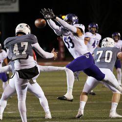 Weber State Wildcats linebacker Auston Tesch blocks a punt by Southern Utah Thunderbirds punter Rashaan Miller during NCAA football in Cedar City on Saturday, Dec. 2, 2017.