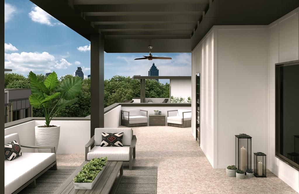 A large terrace atop a white townhome.