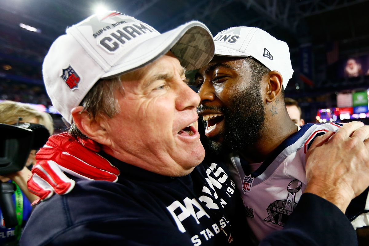 Bill Belichick and Darrell Revis celebrate the gay marriage amicus brief...oh wait, they're celebrating their Super Bowl win.