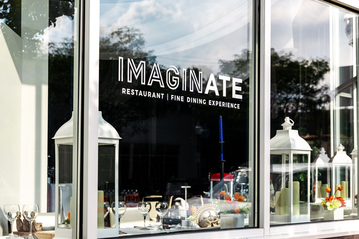 The front window reads Imaginate Restaurant | Fine Dining Experience