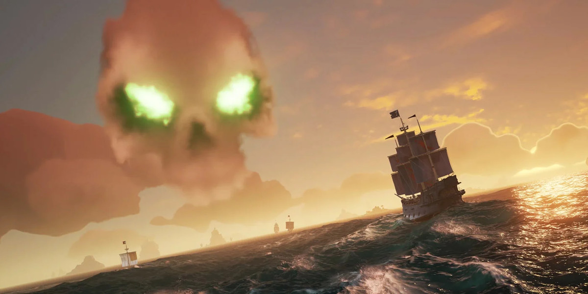 a Sea of Thieves screenshot showing with ships approaching a skeleton fort in the world.