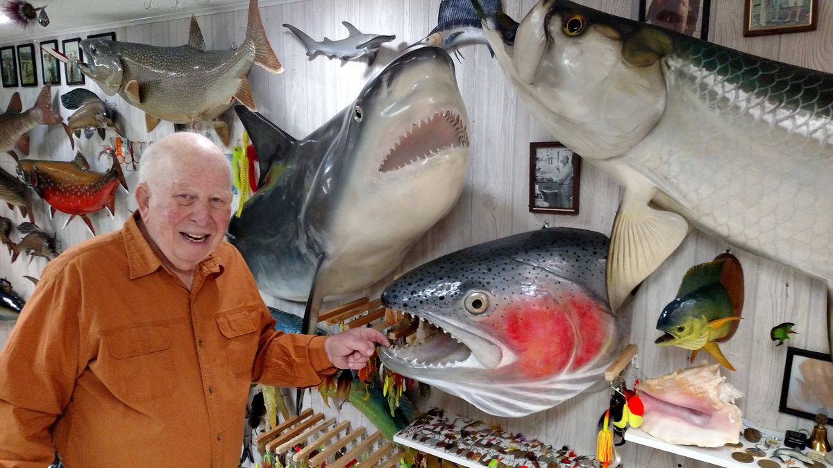 Don Dubin has fun with some of the more striking mounts in his museum-quality collection of fishing history.<br>Credit: Dale Bowman