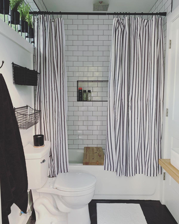 A bathroom with subway tile.