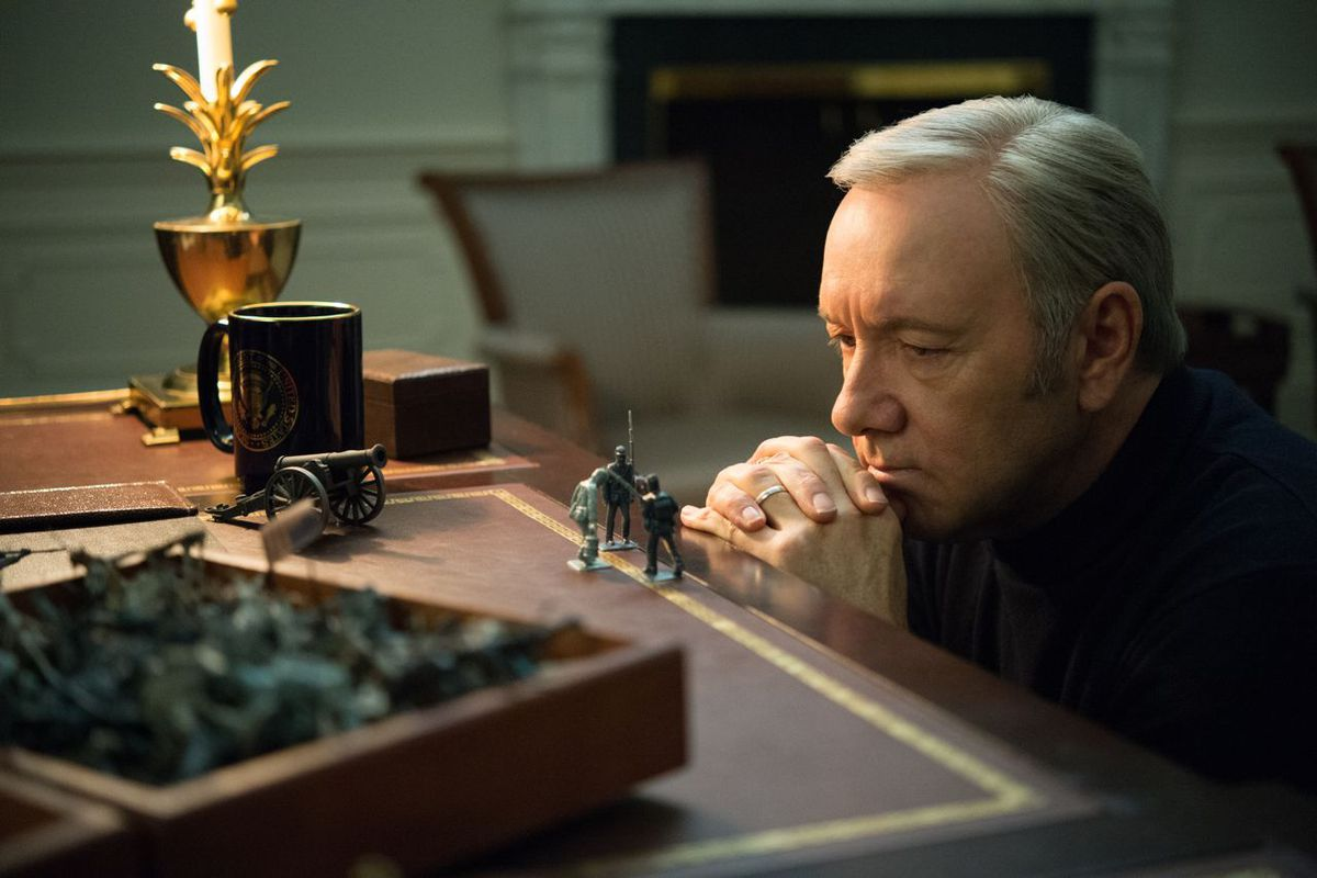 Frank (Kevin Spacey) games out some scenarios for his toy soldiers.