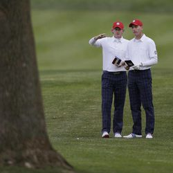 USA's Jim Furyk, right, and Brandt Snedeker look over a shot on the fifth hole during a foursomes match at the Ryder Cup PGA golf tournament Friday, Sept. 28, 2012, at the Medinah Country Club in Medinah, Ill.