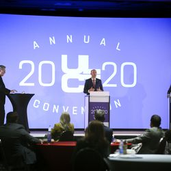 Moderator Doug Wilks, editor of the Deseret News, poses a question for Utah gubernatorial candidates Republican Lt. Gov. Spencer Cox, left, and Democrat Chris Peterson during the Utah League of Cities and Towns' virtual annual convention at the Salt Palace in Salt Lake City on Friday, Sept. 25, 2020.