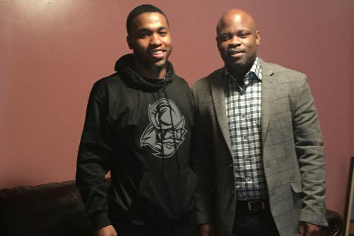 Elijah Battle and West Virginia cornerbacks coach Brian Mitchell
