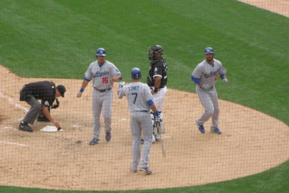 Matt Kemp celebrates with Andre Ethier and James Loney after hitting a home run in the sixth inning today.