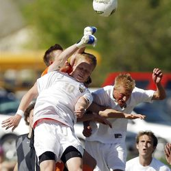 Weber's goal keeper Timothy Wheelwright, back left, punches the ball away from Davis' #10 John Taylor, left, and #13 Cooper VanderMerwe as Davis and Weber play Tuesday, April 24, 2012.
