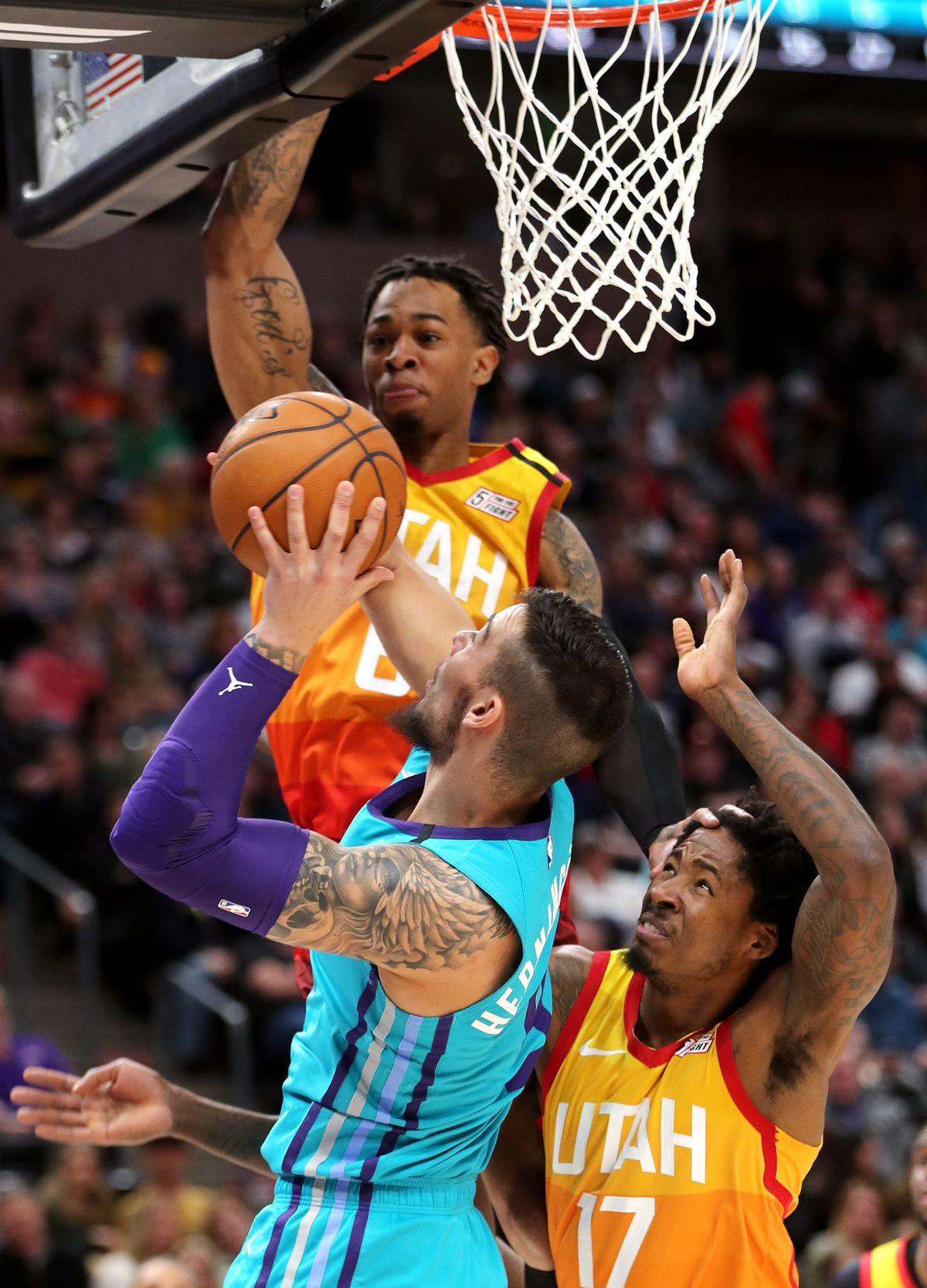 Utah Jazz guard Rayjon Tucker (6) and Utah Jazz center Ed Davis (17) work to defend Charlotte Hornets center Willy Hernangomez (9) as the Utah Jazz and the Charlotte Hornets play an NBA basketball game at Vivint Arena in Salt Lake City on Friday, Jan. 10, 2020. Utah won 109-92.