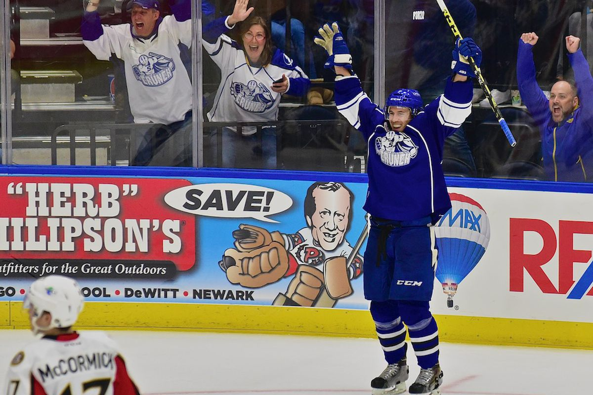 Syracuse Crunch forward Jeff Tambellini celebrates one of his goals this past Saturday night when the Syracuse Crunch opened their home schedule against the Binghamton Senators. Syracuse won the game 2-1.