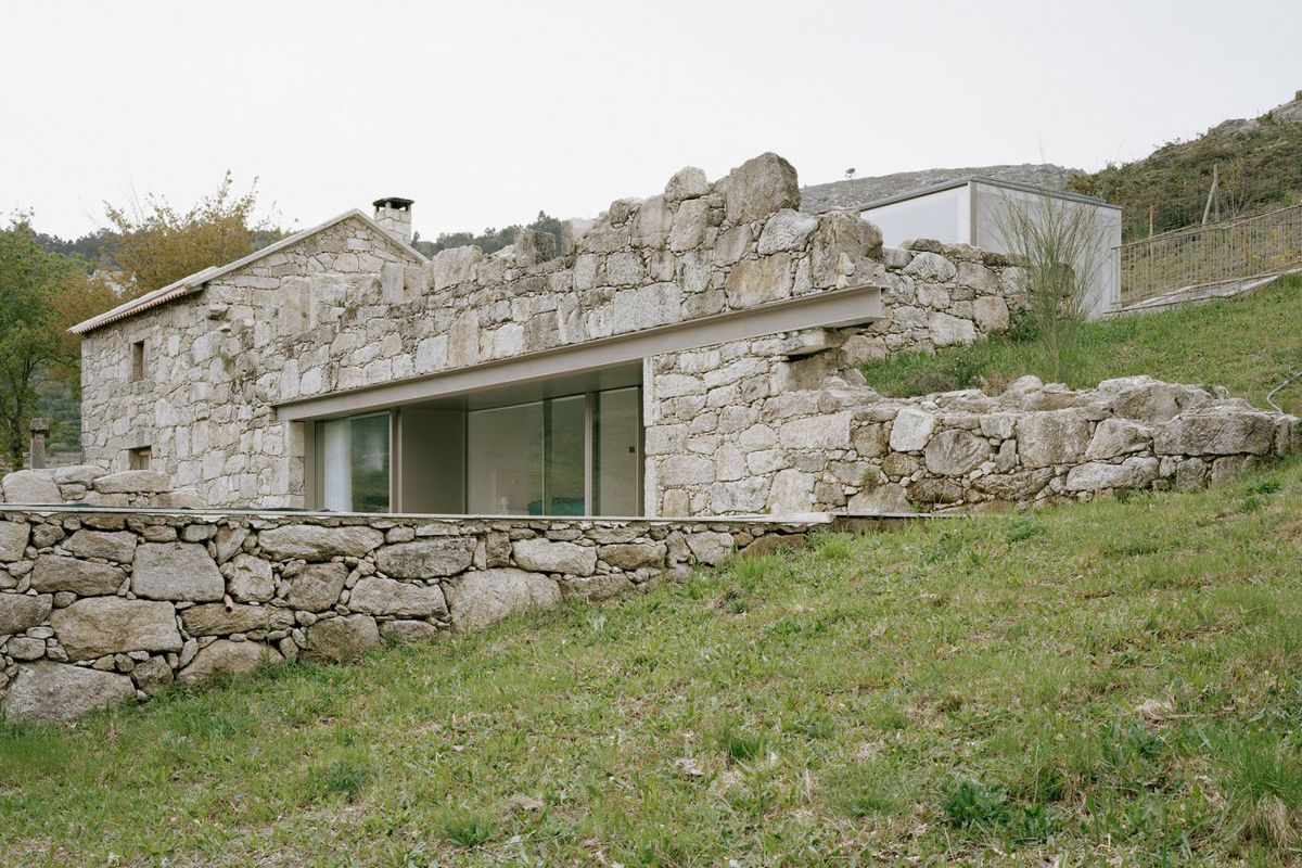 Contemporary stone house rises from old ruins in portugal Modern stone house