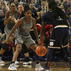 Notre Dame's Lili Thompson (1) is guarded by UConn's Crystal Dangerfield (5) during the Notre Dame Fighting Irish vs UConn Huskies women's college basketball game in the Women's Jimmy V Classic at the XL Center in Hartford, CT on December 3, 2017.