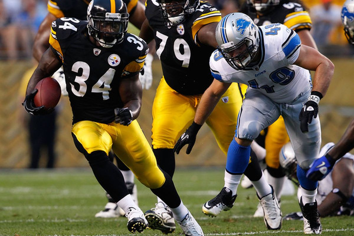 PITTSBURGH - AUGUST 14:  Rashard Mendenhall #34 of the Pittsburgh Steelers runs by Zach Follet #49 of the Detroit Lions during the preseason game on August 14 2010 at Heinz Field in Pittsburgh Pennsylvania.  (Photo by Jared Wickerham/Getty Images)