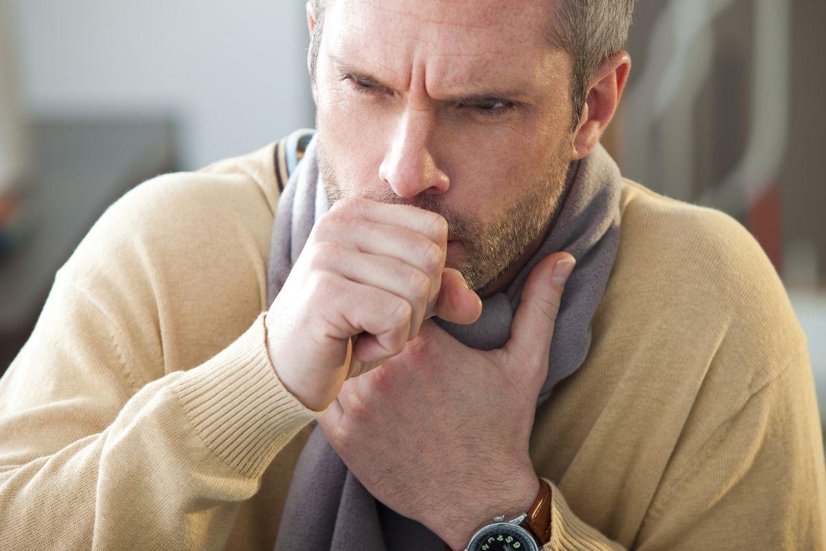 A man coughs.