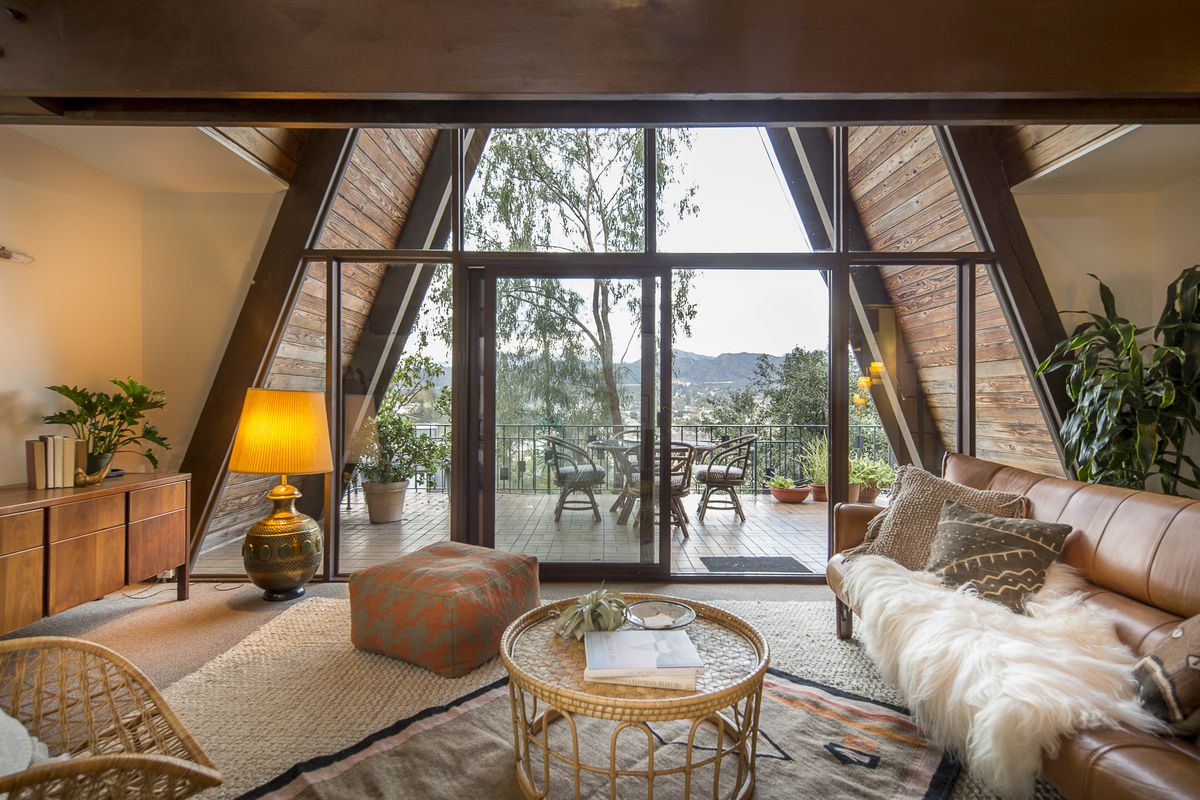An interior shot of the A-frame that shows off both the view and high pitch of the ceiling.