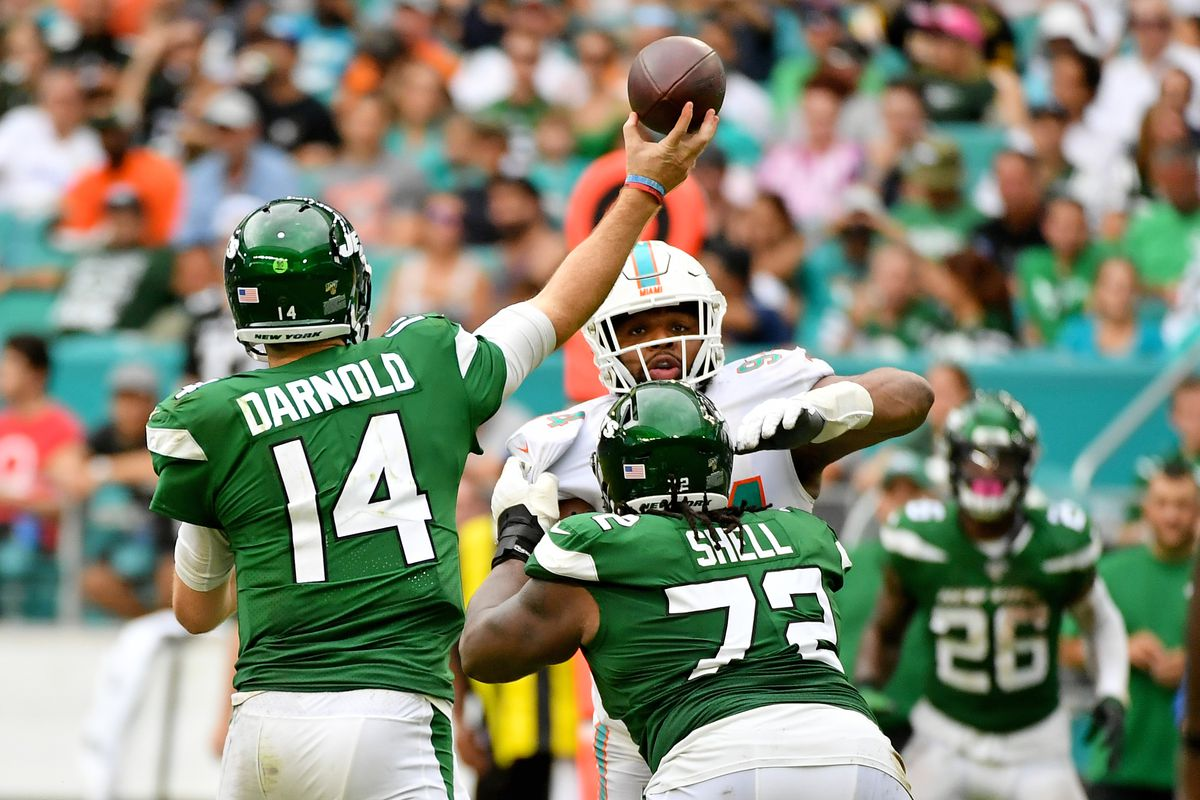 New York Jets quarterback Sam Darnold attempts a pass against the Miami Dolphins during the second half at Hard Rock Stadium.