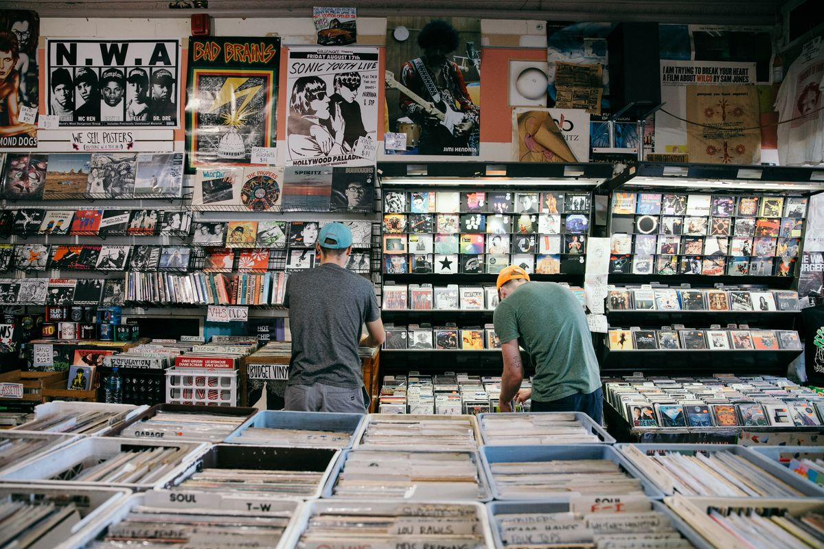Two shoppers looking through records.