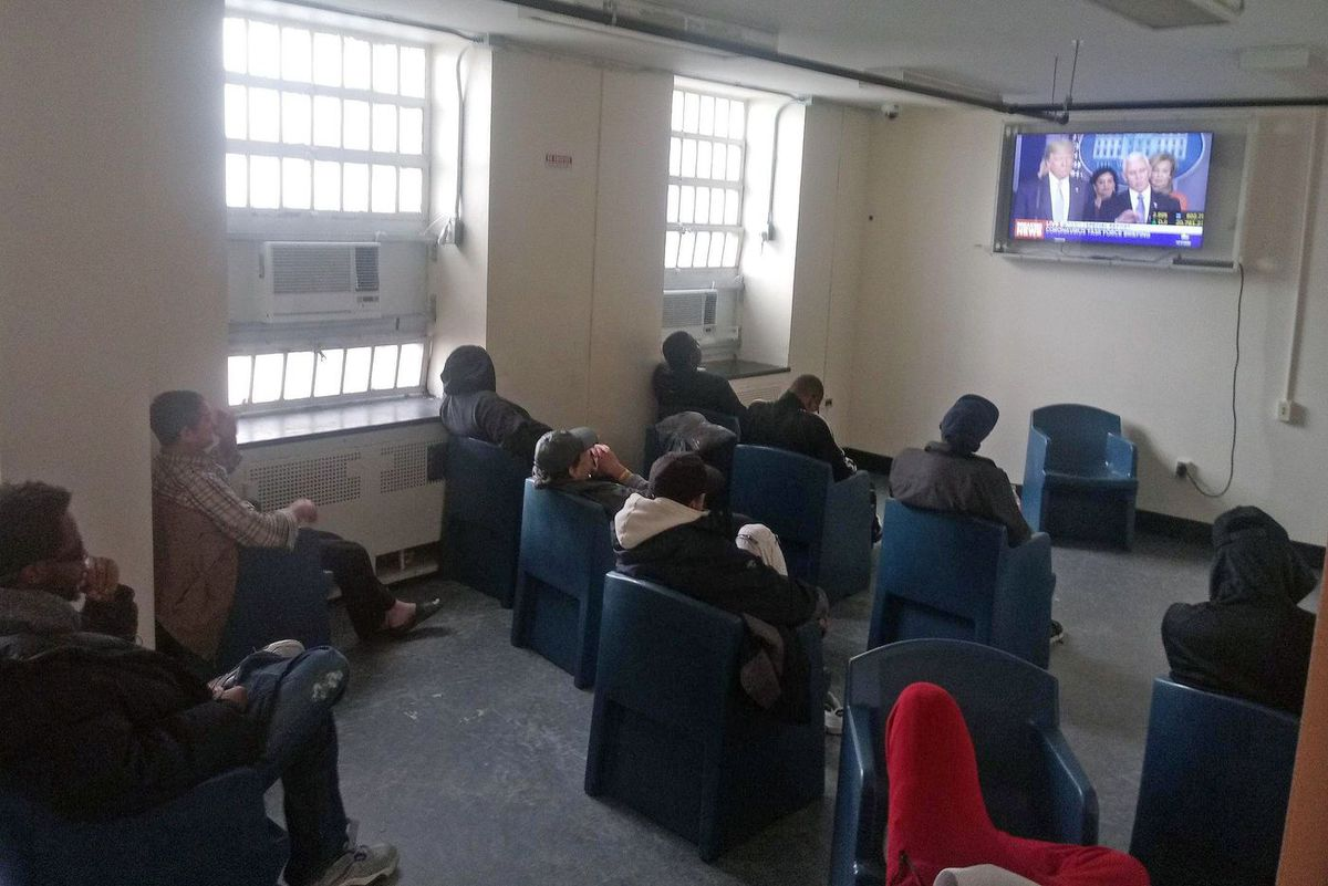 The common room in a Help USA shelter on Wards Island was filled with people in March 17 before the Department of Homeless Services started allowing clients to stay in their rooms during the day.