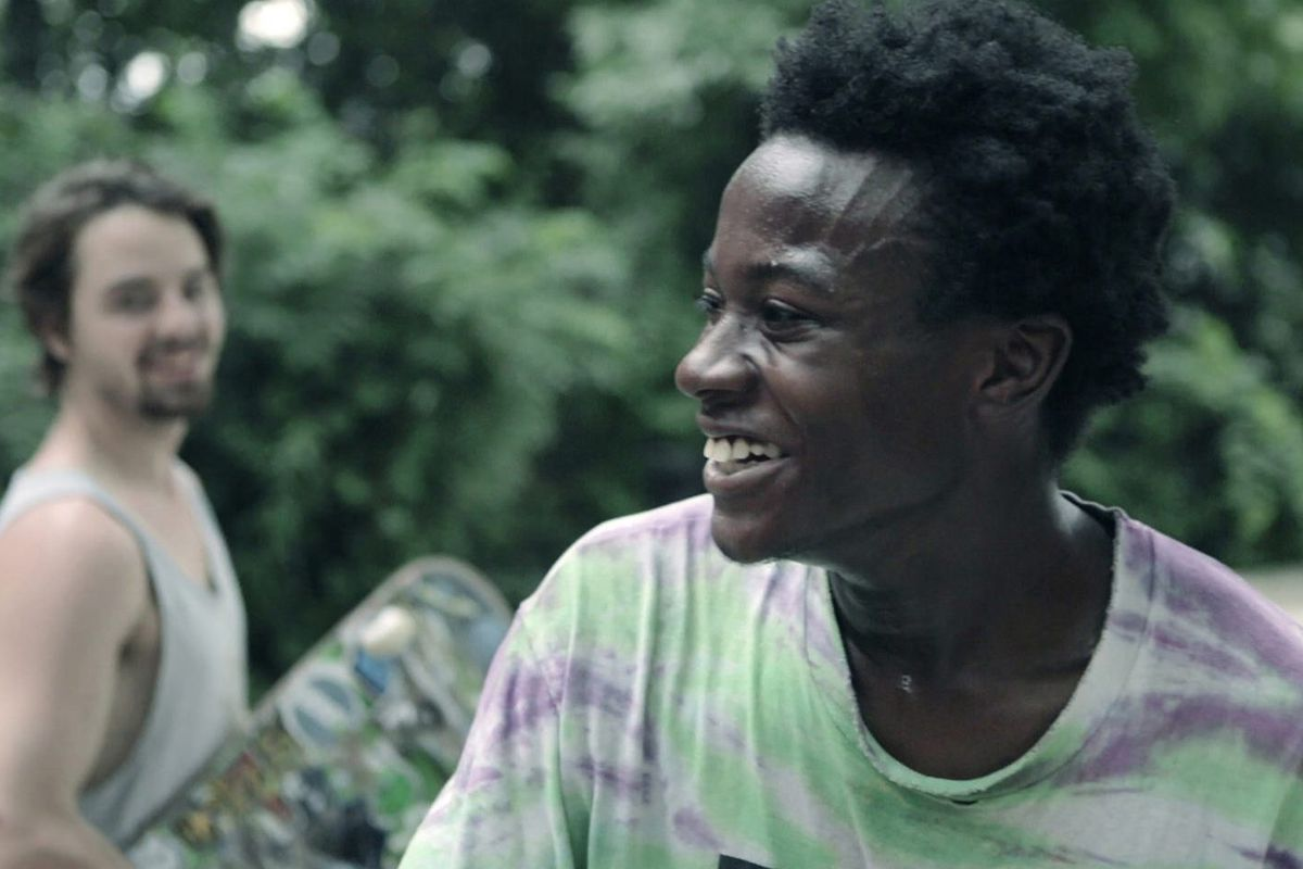 A still of a man smiling in 'Minding the Gap'