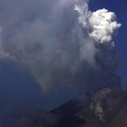 A plume of ash rises from the crater of the Popocatepetl volcano seen from the town of San Nicolas de los Ranchos, Mexico, Friday April 20, 2012.  Authorities prepared evacuation routes, ambulances and shelters in the event of a bigger explosion after the volcano that looms over Mexico City emitted a low-pitched roar early Friday morning and spewed ash and steam.