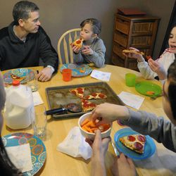 The Griffins sit down for dinner in their home in West Jordan on Thursday, Feb. 27, 2014.