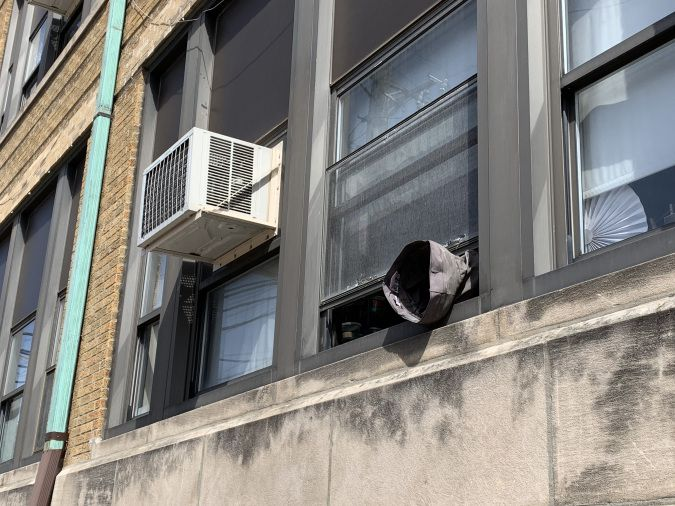 A ventilation tube hangs out of a window at Camras Elemntary School on Wednesday. | Mitchell Armentrout/Sun-Times