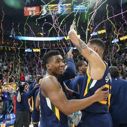 Utah Jazz guard Donovan Mitchell (45) and forward Thabo Sefolosha (22) celebrate their 104-101 win over the Cleveland Cavaliers at Vivint Arena in Salt Lake City on Saturday, Dec. 30, 2017. Mitchell led the Jazz in scoring with 29 points.
