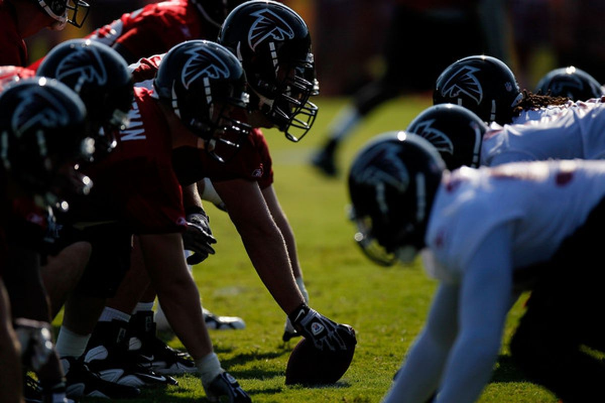 FLOWERY BRANCH GA - JULY 30:  The Atlanta Falcons offense lines up against the defense during opening day of training camp on July 30 2010 at the Falcons Training Complex in Flowery Branch Georgia.  (Photo by Kevin C. Cox/Getty Images)
