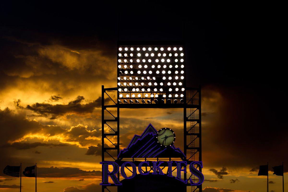 DENVER, CO - JUNE 26:  The sun sets behind the scoreboard during the sixth inning of a game between the Washington Nationals and Colorado Rockies at Coors Field on June 26, 2012 in Denver, Colorado.  (Photo by Justin Edmonds/Getty Images)