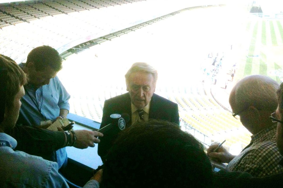 Vin Scully addresses reporters before calling the game between the Los Angeles Dodgers and San Diego Padres at Dodger Stadium on April 15, 2012. Scully missed five games, including the Dodgers home opener, with a bad cold.