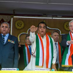 Elder D. Todd Christofferson, a member of the Quorum of Twelve Apostles for The Church of Jesus Christ of Latter-day Saints, right, join other dignitaries in taking a pledge during the 71st Independence Day celebrations at the MIT World Peace university in Pune, Maharashtra, India on August 15, 2017.