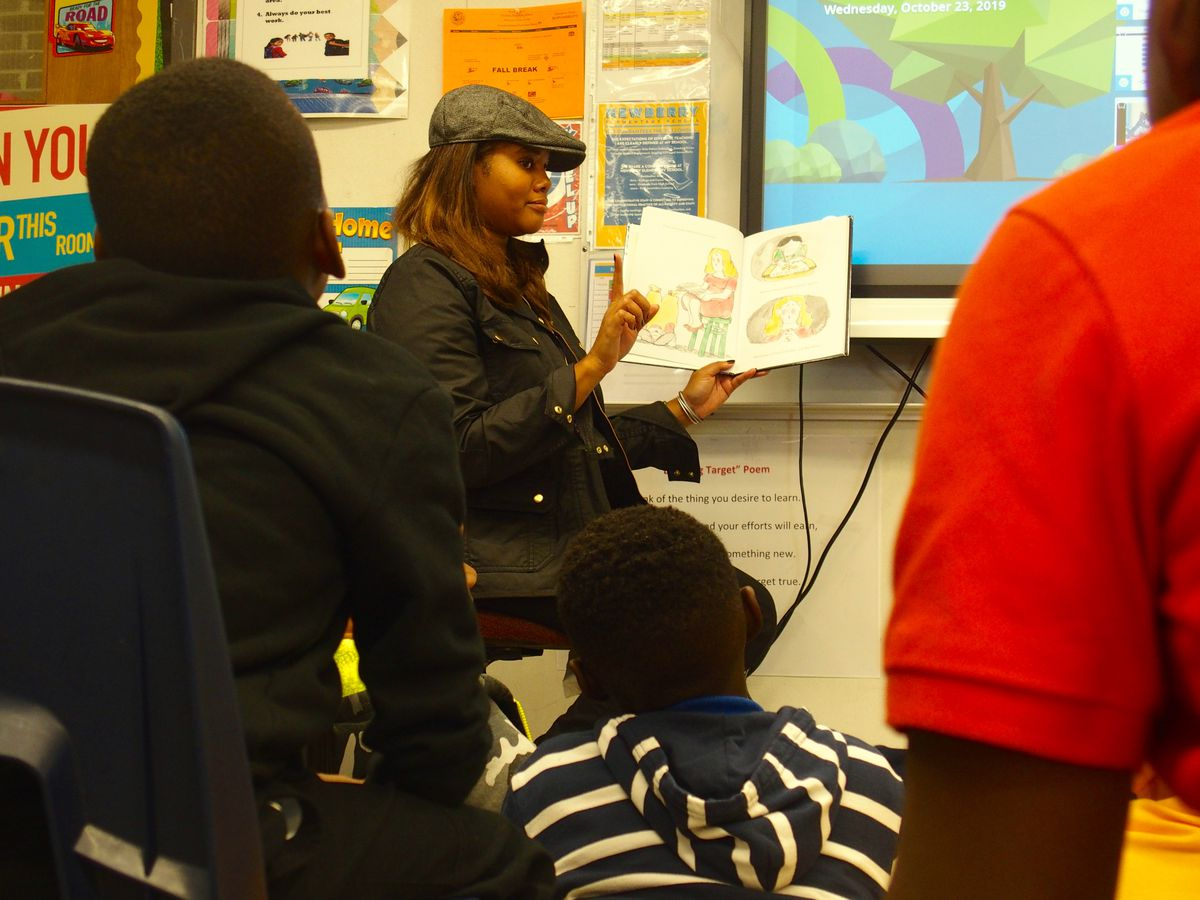 Shelby County school board chairwoman Miska Clay Bibbs reads to students at Newberry Elementary.