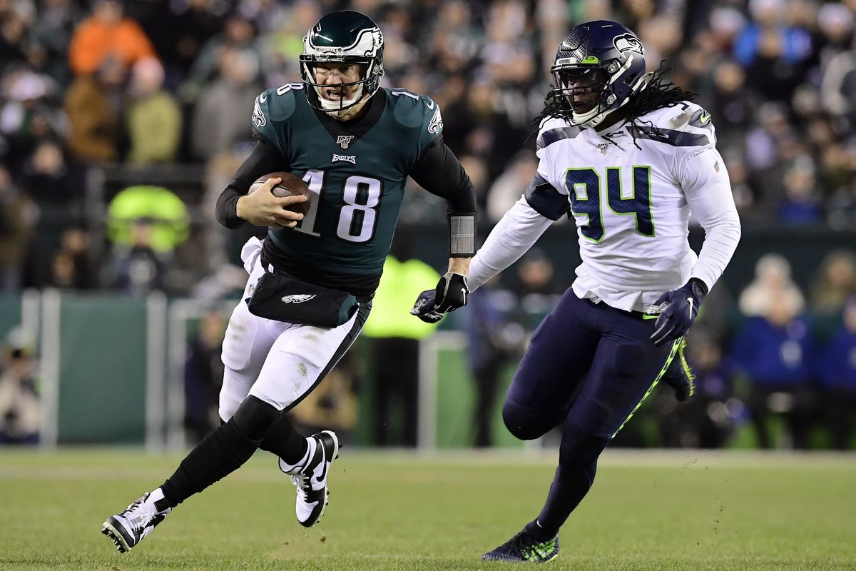 Quarterback Josh McCown of the Philadelphia Eagles runs for a first down over Ezekiel Ansah of the Seattle Seahawks during the NFC Wild Card Playoff game at Lincoln Financial Field on January 05, 2020 in Philadelphia, Pennsylvania.