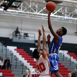 Crane's Rashad Harris (2) scores over Maine South's Kavin Wattanayuth (20) in their 60-40 loss in Park Ridge, Saturday, February 9 2019.   Kevin Tanaka/For the Sun Times