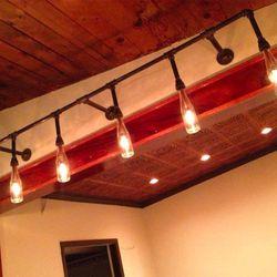 A custom light fixture made from beer bottles.