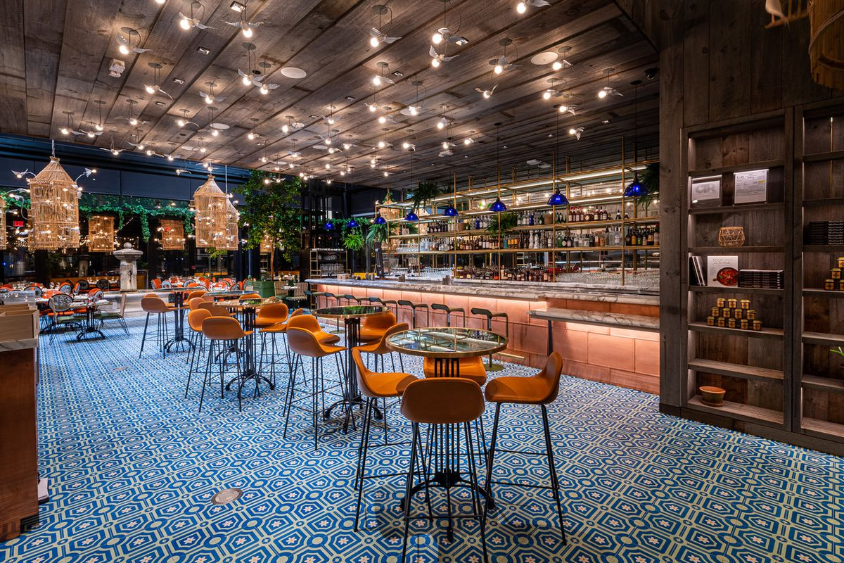 Ilili's dining room features reclaimed woods, a copper bar, and daisy-shaped blue tiles.