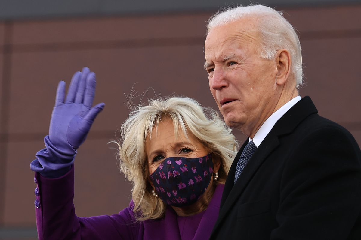 """With tears in his eyes, President-elect Joe Biden (R) and Dr. Jill Biden participate in a farewell ceremony at the Major Joseph R. """"Beau"""" Biden III National Guard/Reserve Center January 19, 2021 in New Castle, Delaware."""