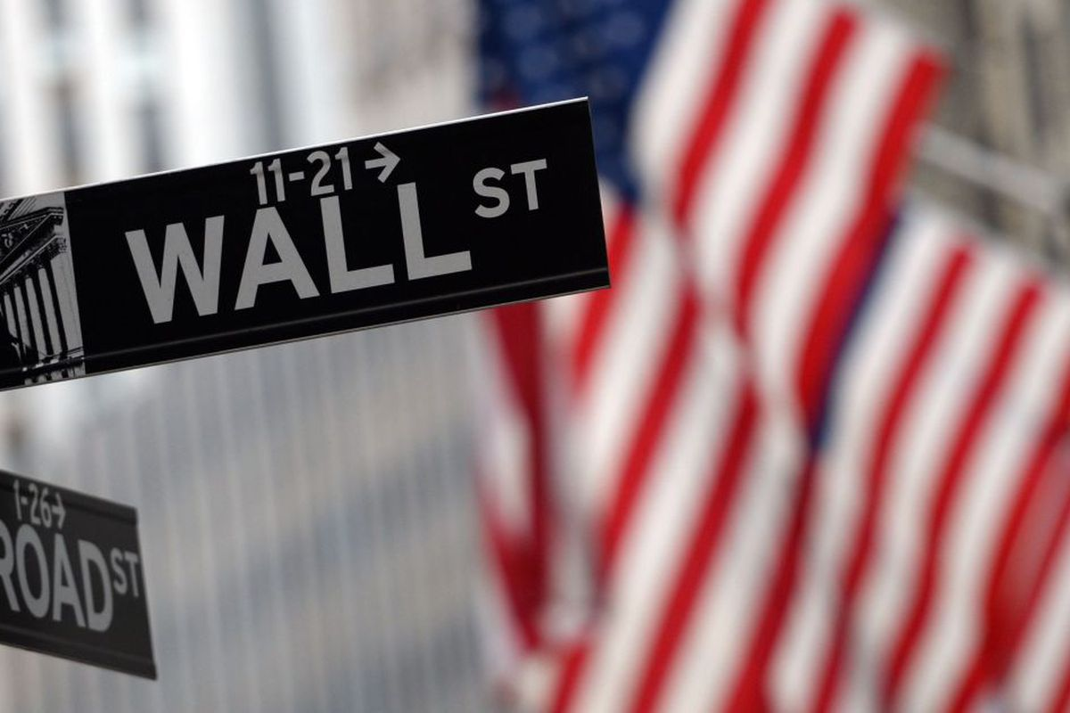 a sign at the corner of Wall and Broad Street across from the New York Stock Exchange.