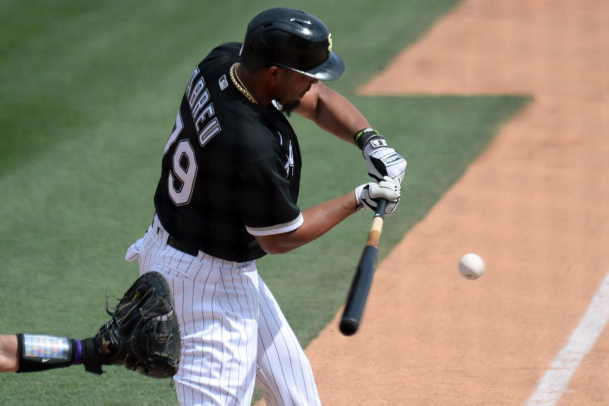 Chicago White Sox first baseman Jose Abreu bats against the Colorado Rockies during the third inning of a spring training game against the Colorado Rockies at Camelback Ranch.