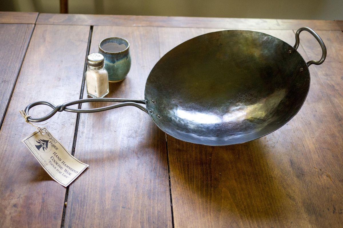 A hand-hammered work on a wooden table.